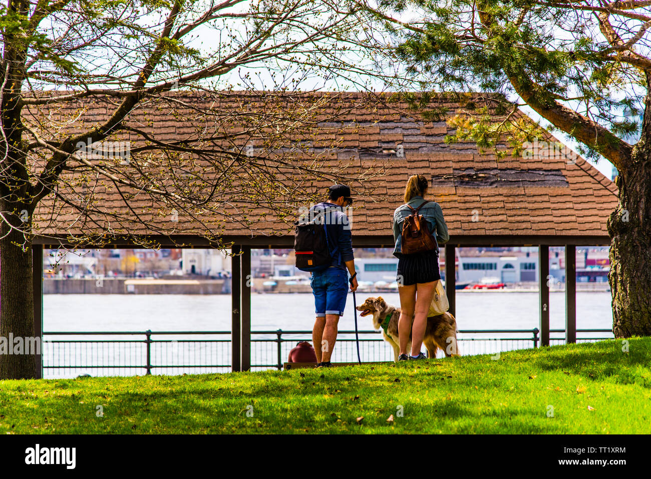 People enjoying the spring time on île saint hélène in Montreal - Stock Image