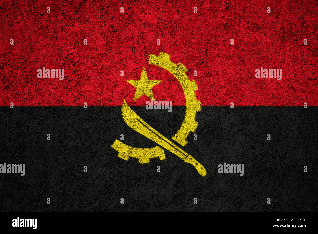 Angola flag painted on the cracked grunge concrete wall Stock Photo