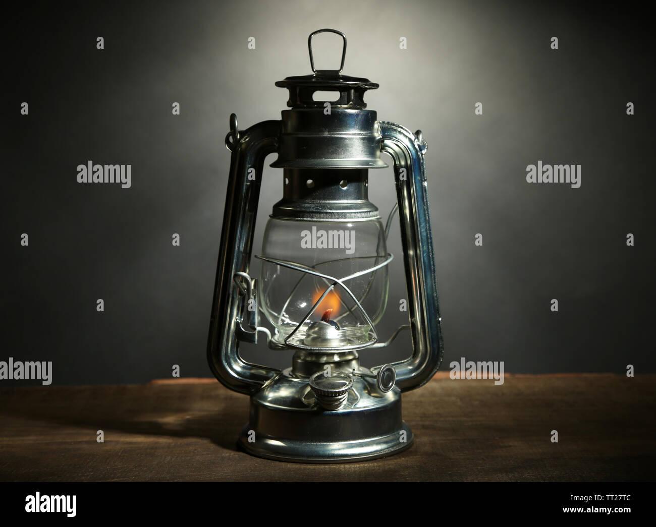 Kerosene lamp on dark grey background - Stock Image