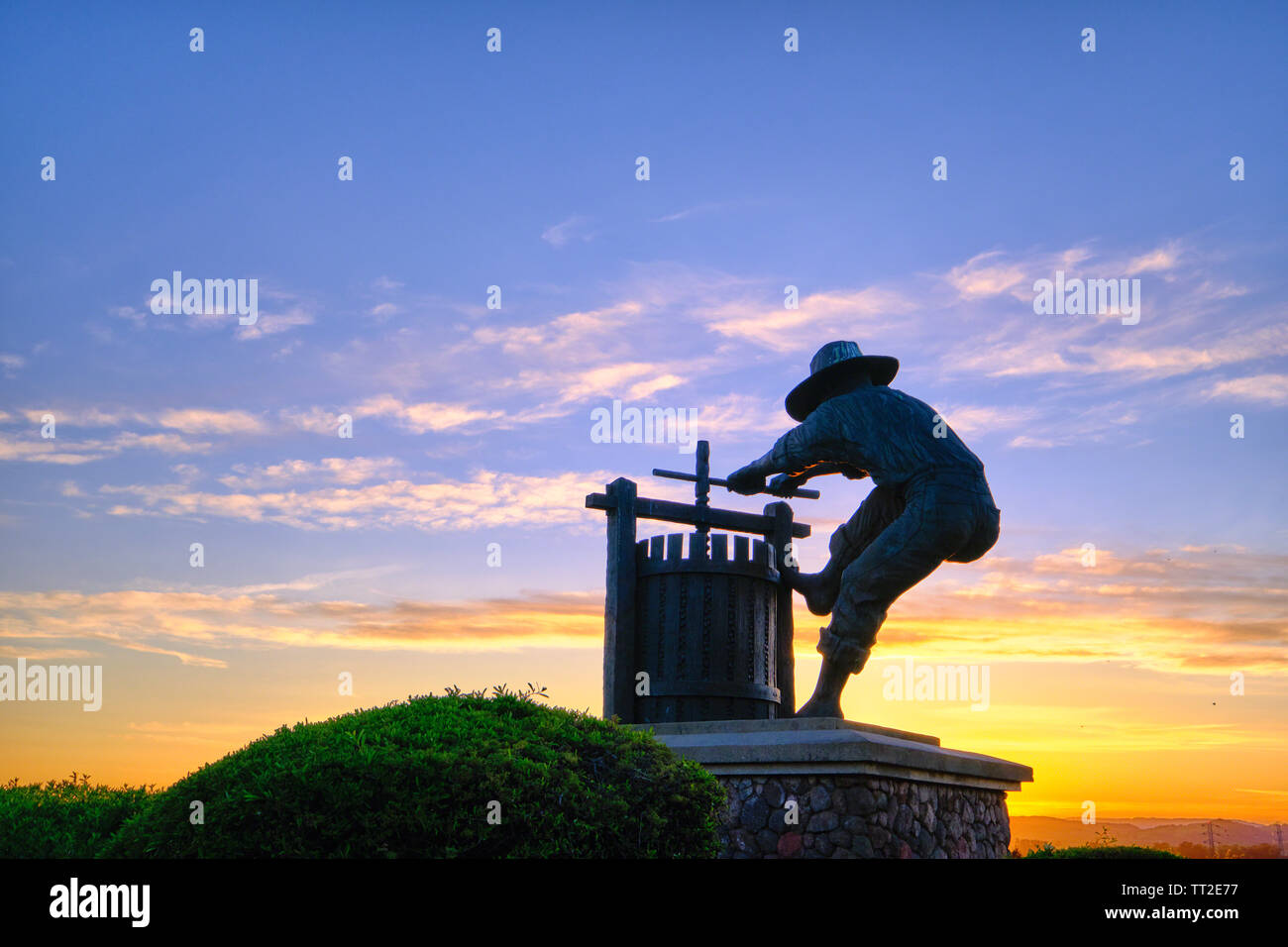 The Grape Crusher Statue agains Dramatic Sky, Napa Valley, California Stock Photo