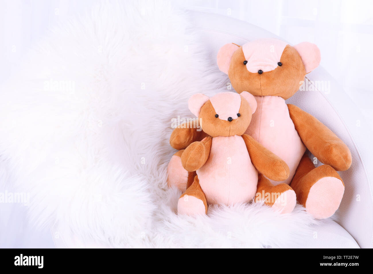 Two bears toy on armchair in room - Stock Image