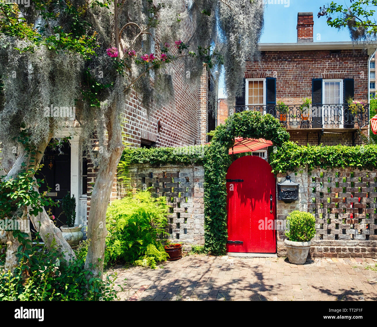 Downtown Street Scene with a Red Door and Historic House, Savannah, Georgia Stock Photo