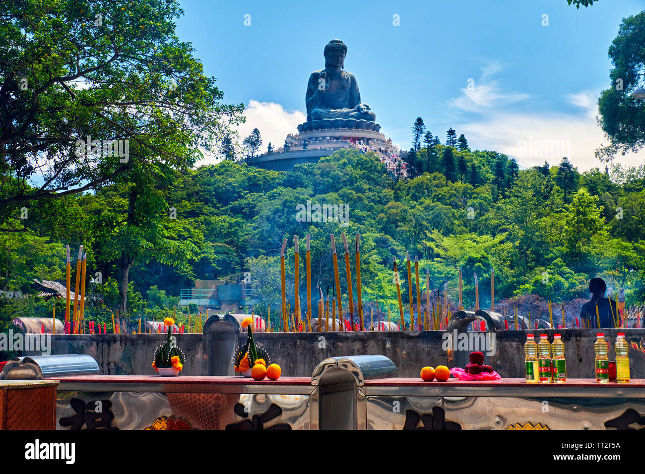Low Angle View of the Tian Tan Buddha Statue with Offerings, Lantau, Hong Kong Stock Photo