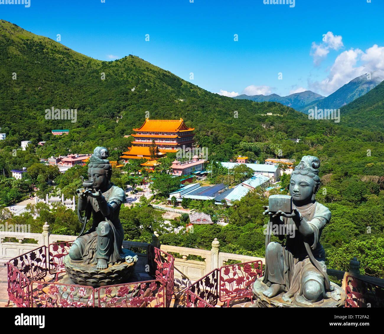 Two of the Six Deva statues Offering Gifts to the Tian Tan Buddha, Lantau Island, Hong Kong Stock Photo