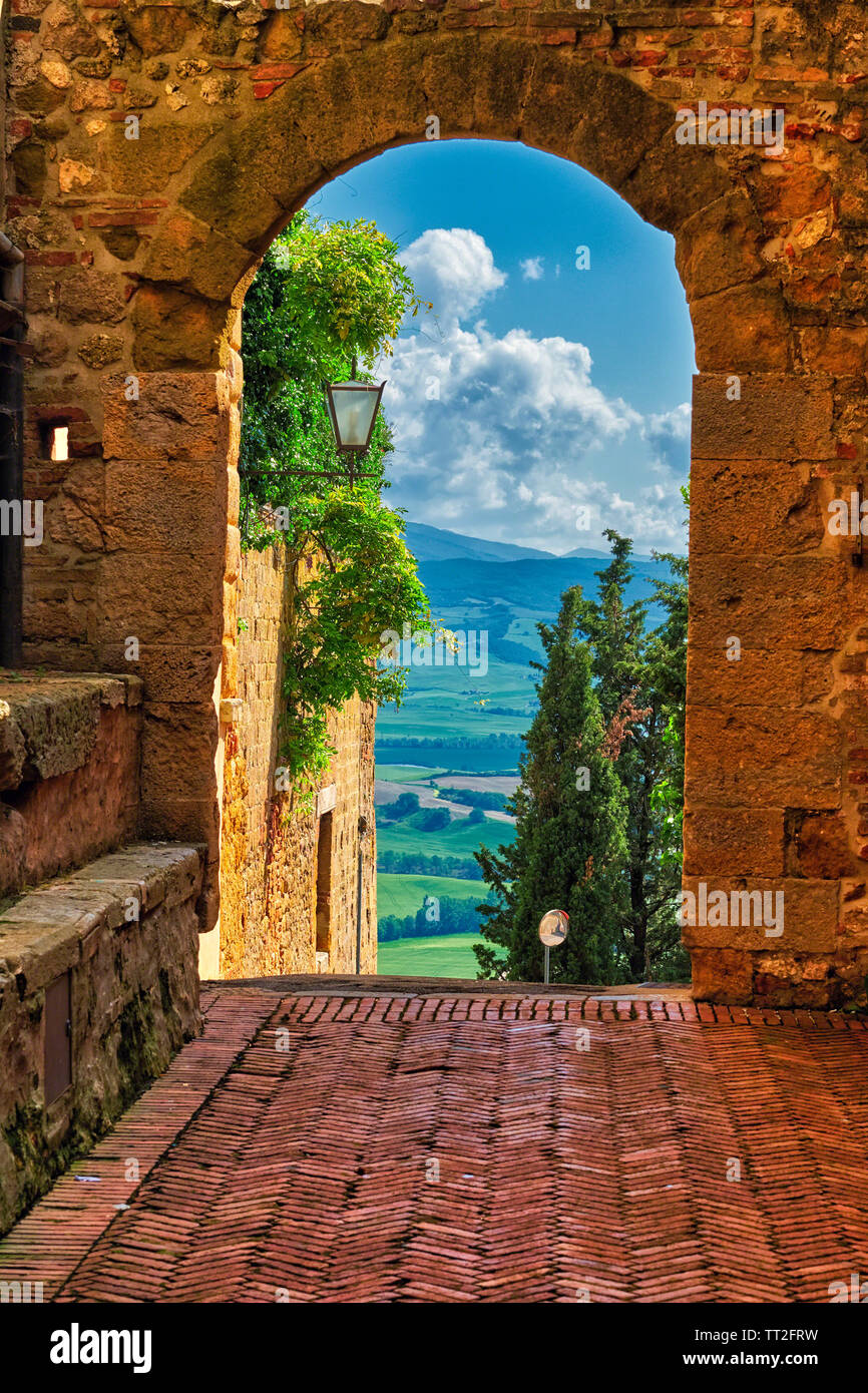 Arch with the View of the Tuscan Countryside, Pienza, Tuscany, Italy Stock Photo