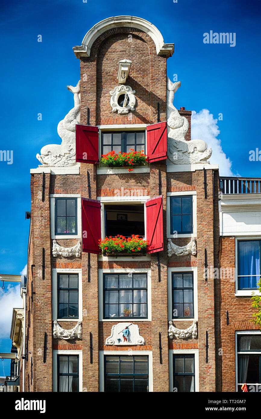 Low Angle Frontal View of an Old Typical Dutch House, Amsterdam, North Holland, Netherlands Stock Photo