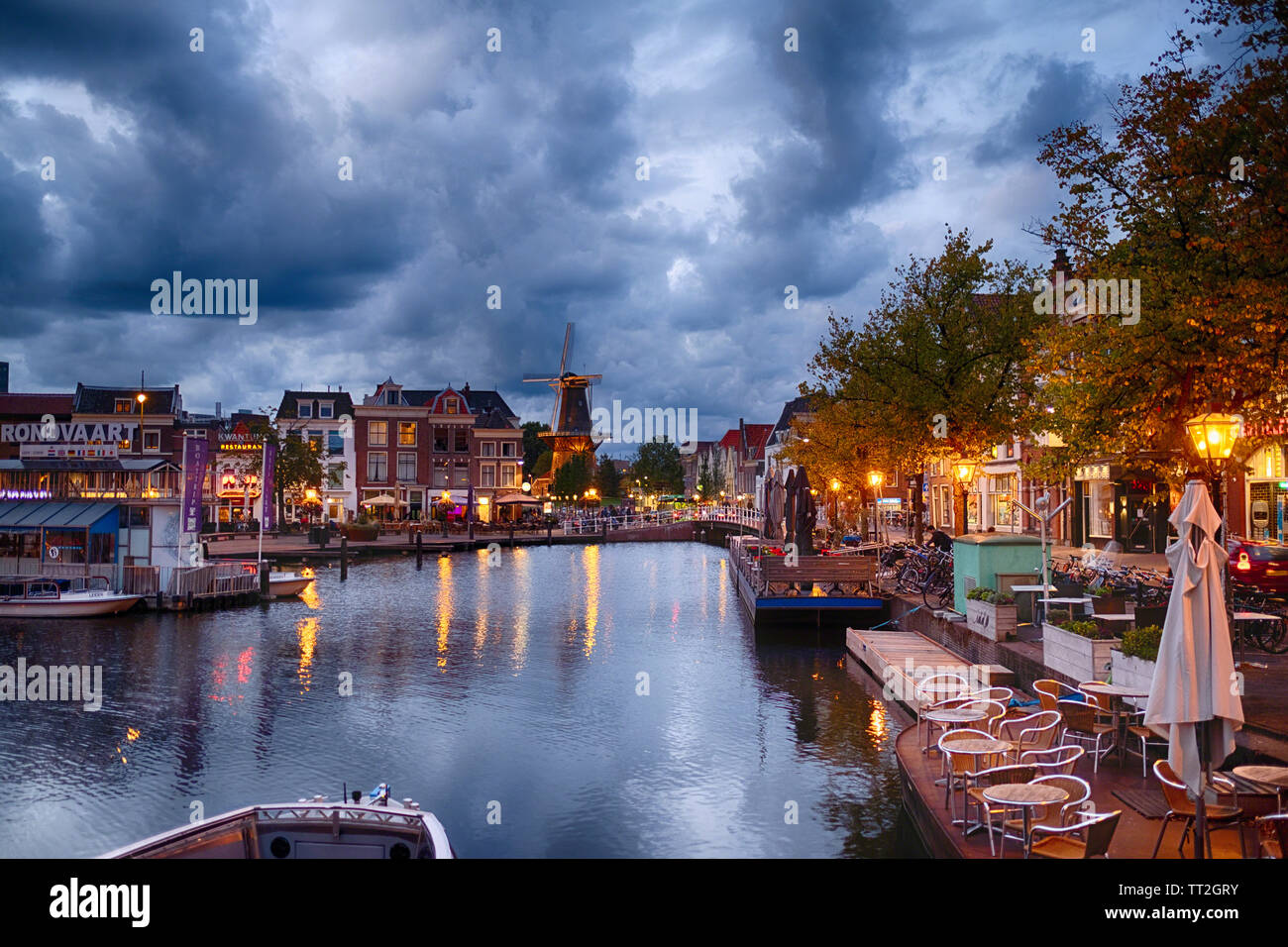 Canal and Windmill in Leiden at Night, Netherlands Stock Photo