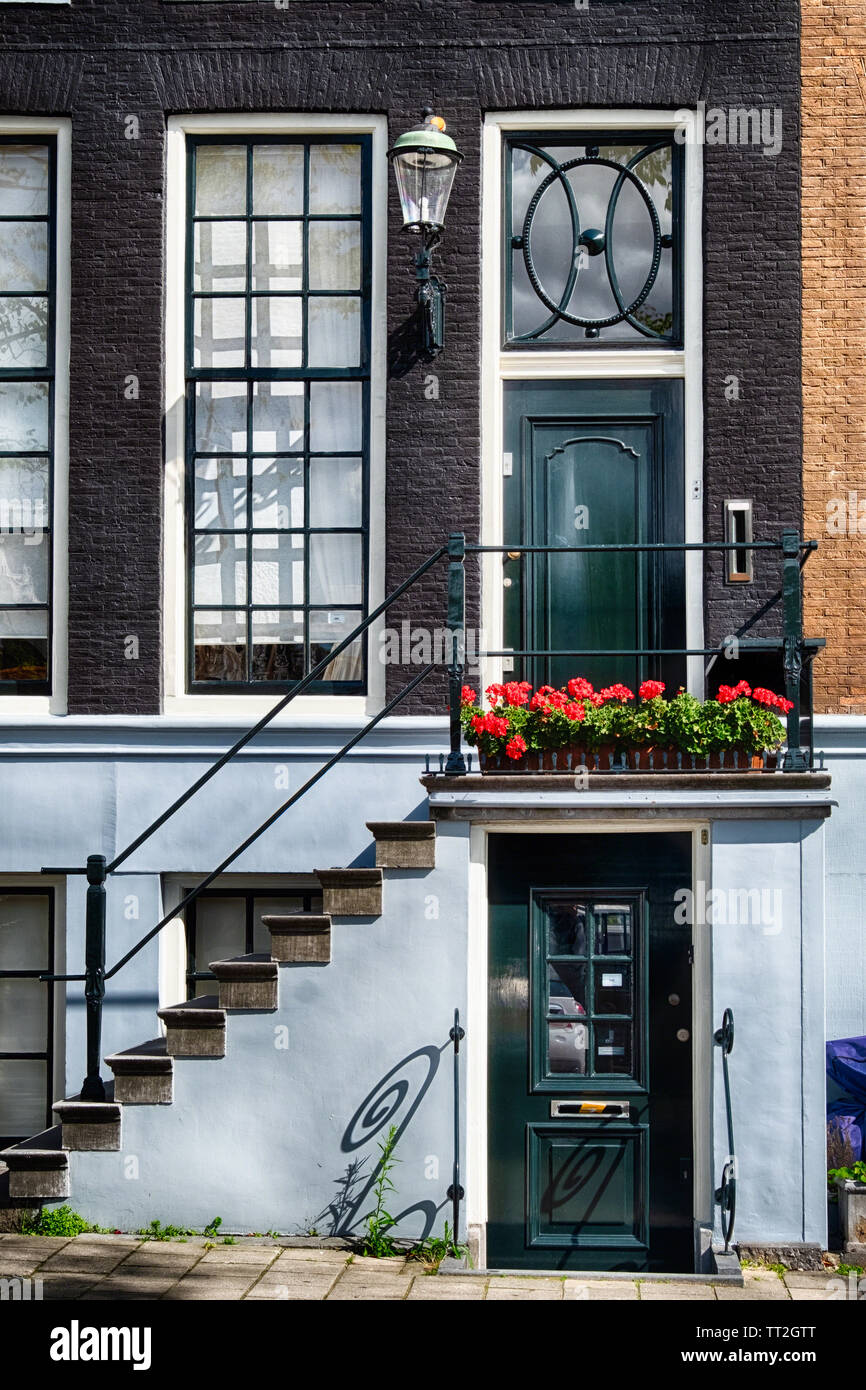 View of a Traditional Dutch House Entrance in Amsterdam, Netherlands Stock Photo