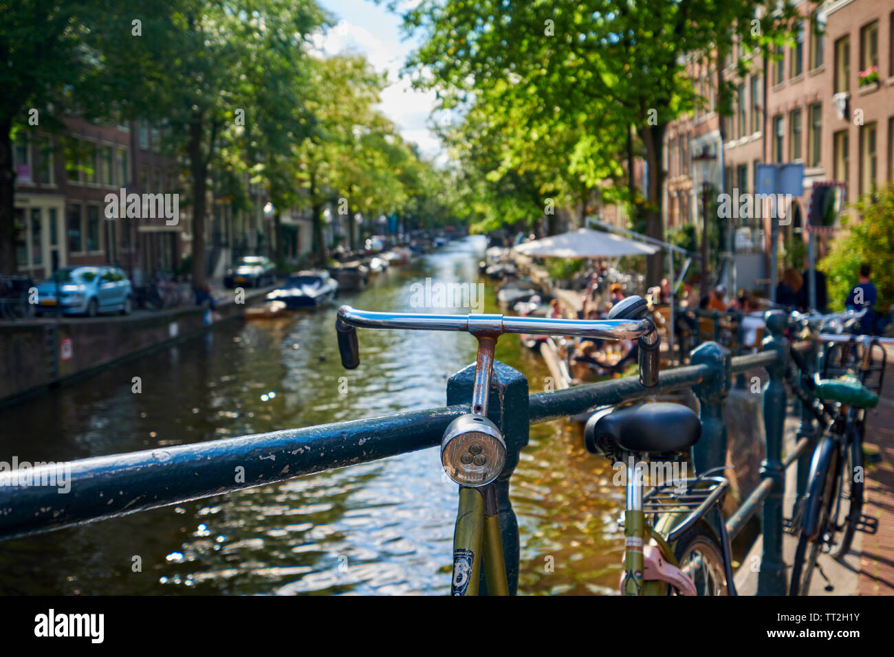 Close Up View of a Classic Old Bicycle on a Small Bridge, Amsterdam, Netherlands Stock Photo