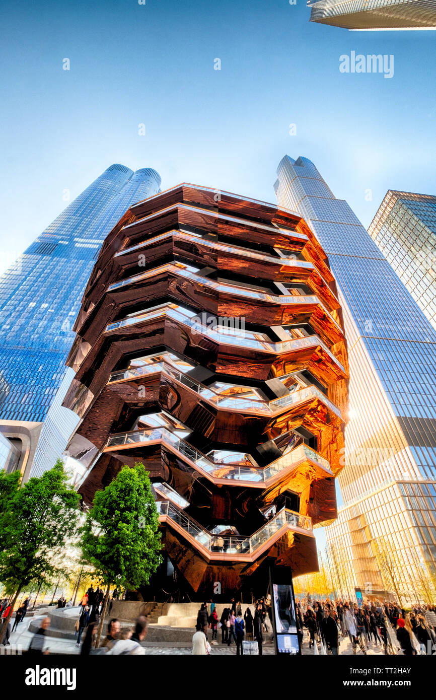 Low Angle View of The Vessel a Structure of Interconnected Stairways between Skyscrapers, Hudson Yards, Manahattan, New York - Stock Image