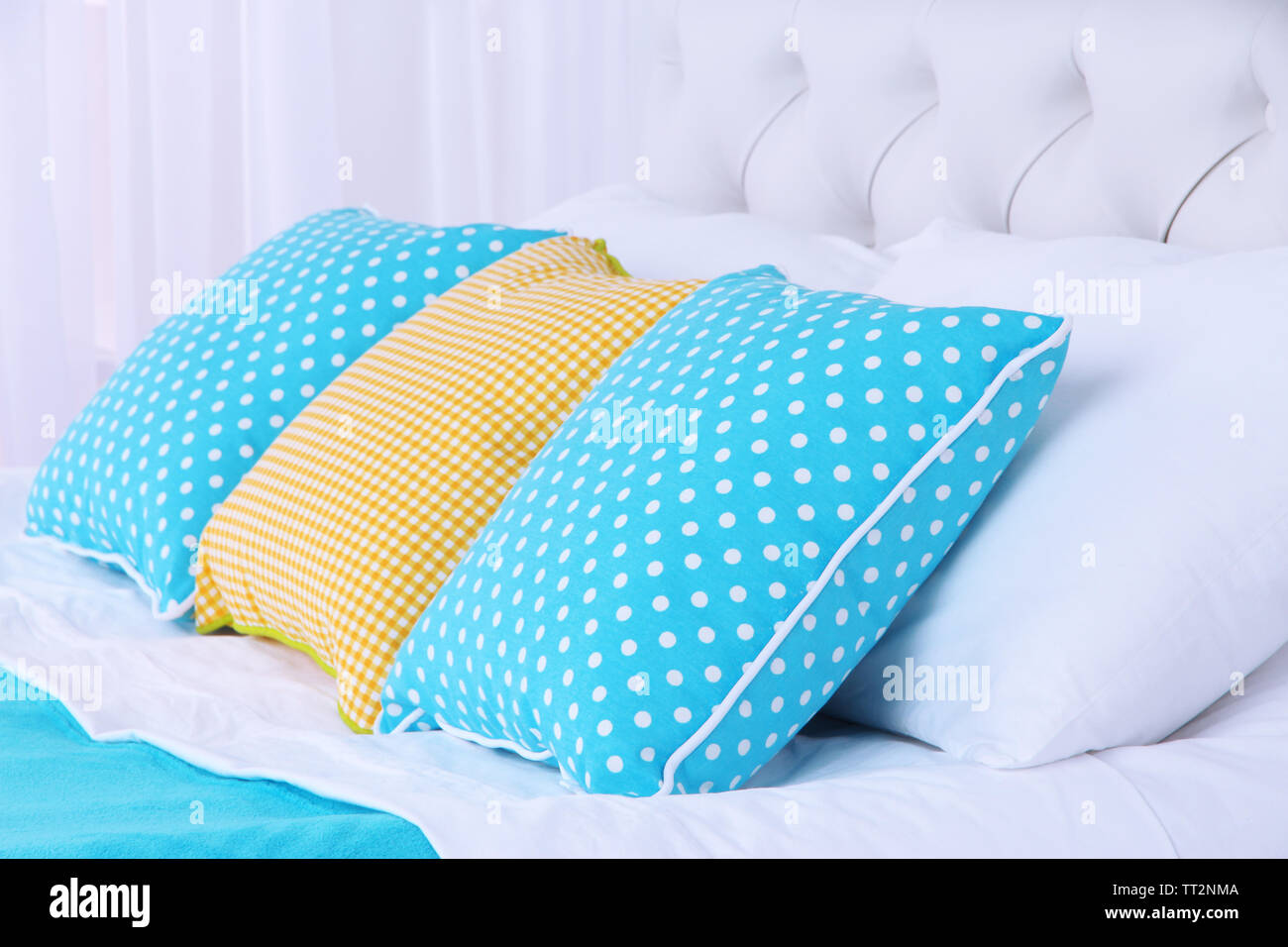 Comfortable soft bed with pillows - Stock Image