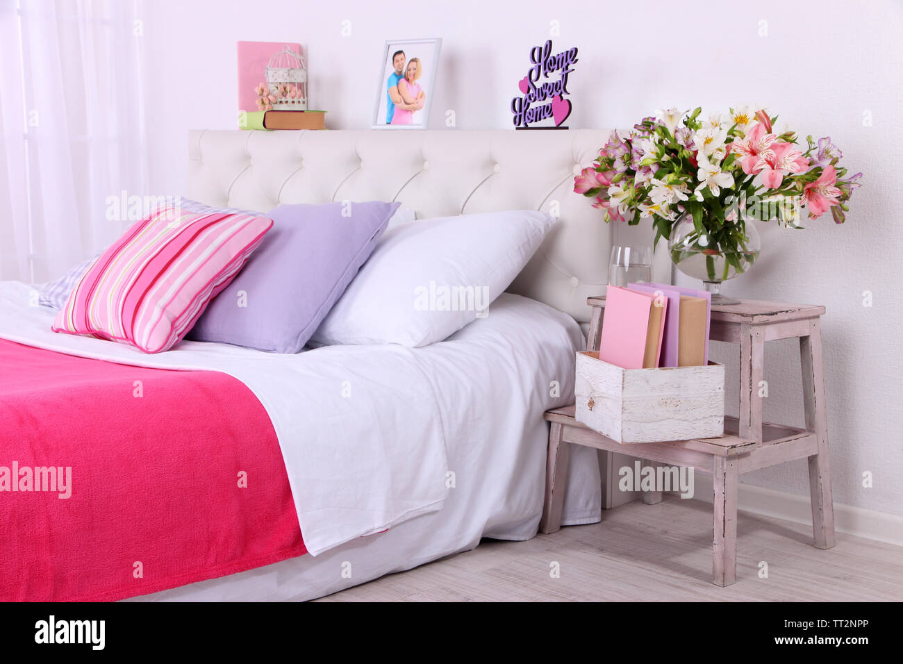Comfortable soft bed in room - Stock Image