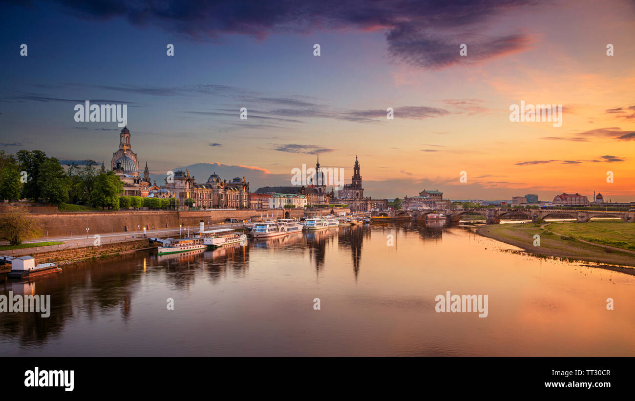 Dresden, Germany. Panoramic cityscape image of Dresden, Germany with reflection of the city in the Elbe river, during sunset. Stock Photo