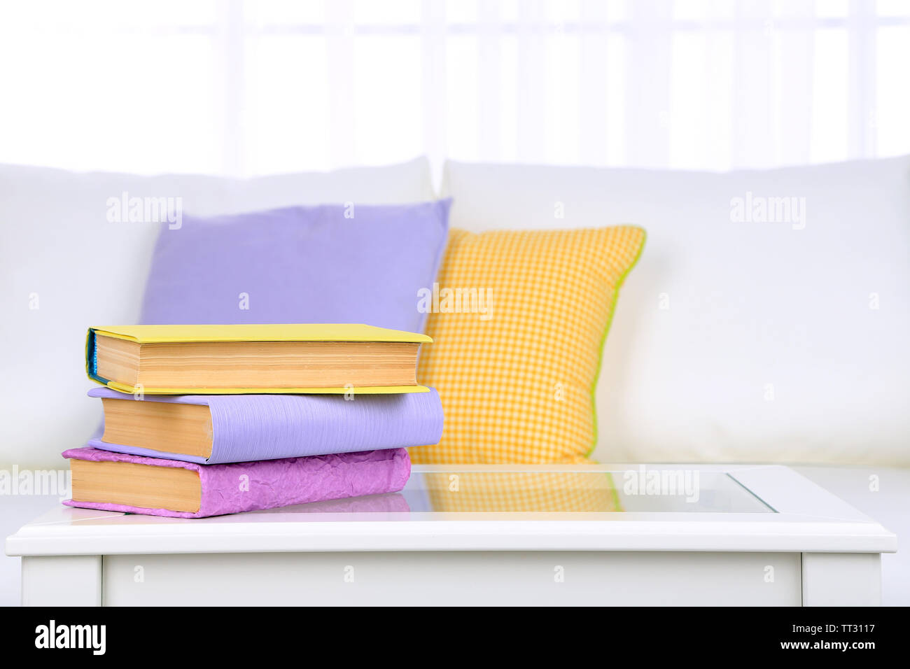 Books on coffee table in room - Stock Image