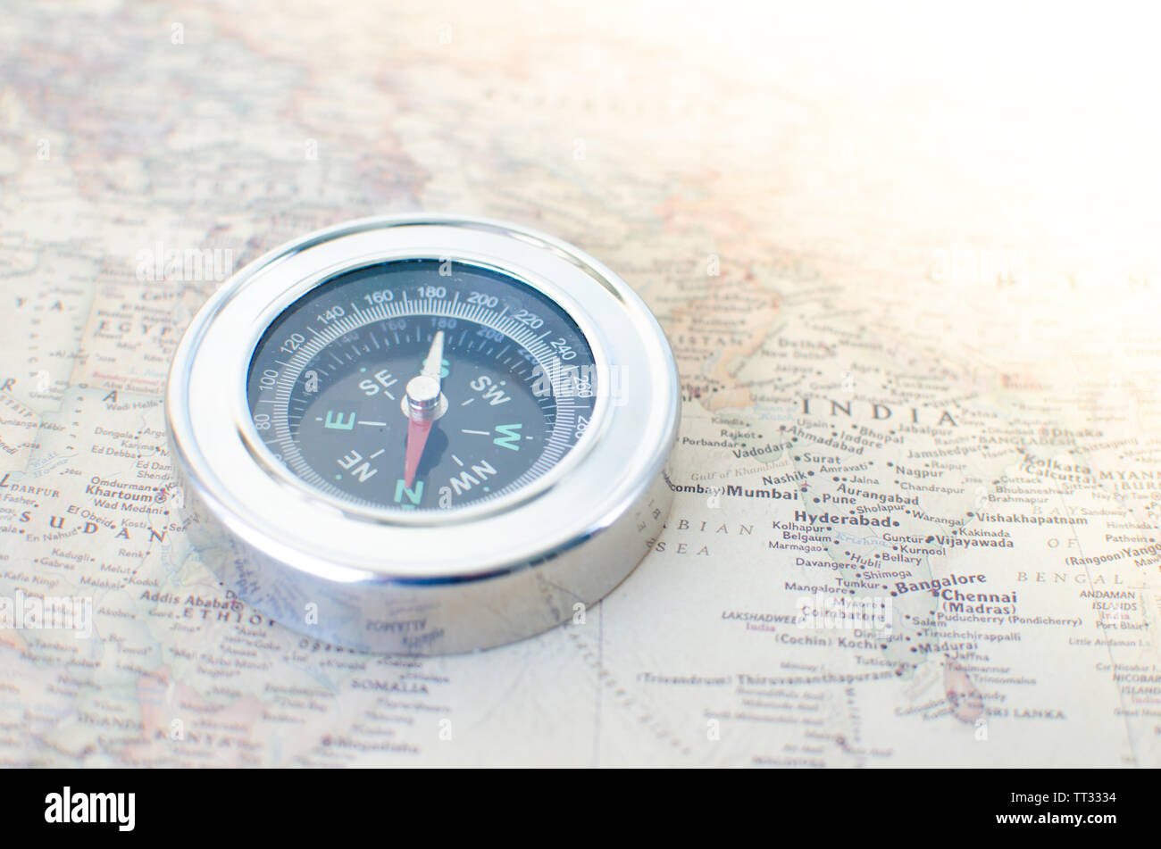Compass on the old map in the rays of the sun Stock Photo ...