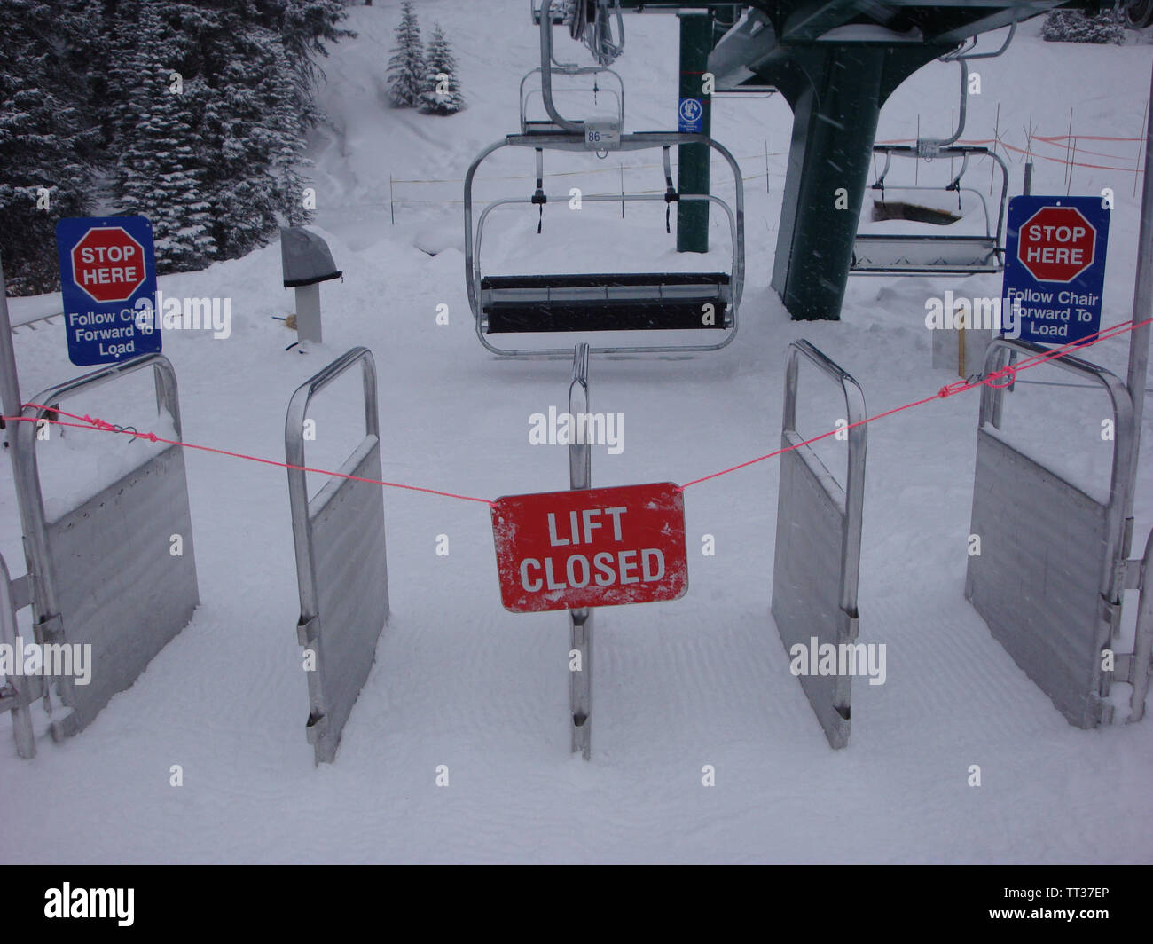Closed Ski lift with red sine  in Canada Stock Photo