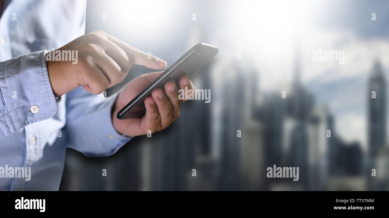 Close-up Young man with smartphone work and talking on the phone - Stock Image