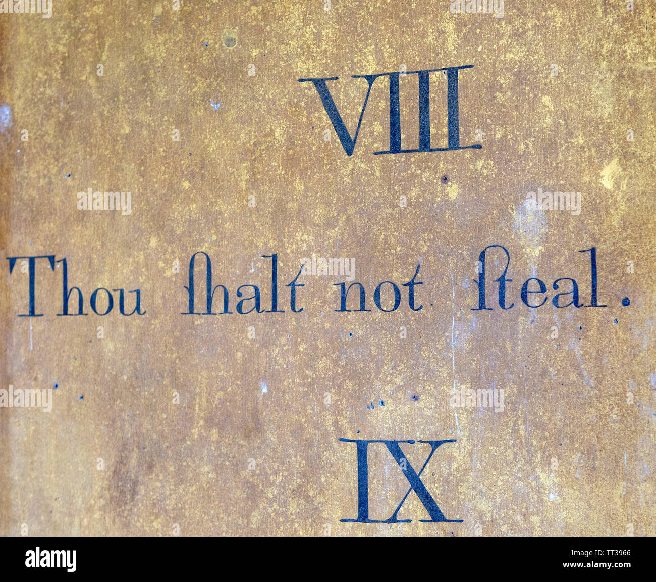 Historic interior of Saint John the Baptist church, Mildenhall, Wiltshire, England, UK 'Thou shalt not steal' commandment - Stock Image