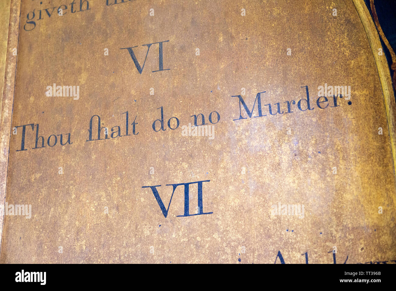 Historic interior of Saint John the Baptist church, Mildenhall, Wiltshire, England, UK 'Thou shalt do no murder' commandment - Stock Image