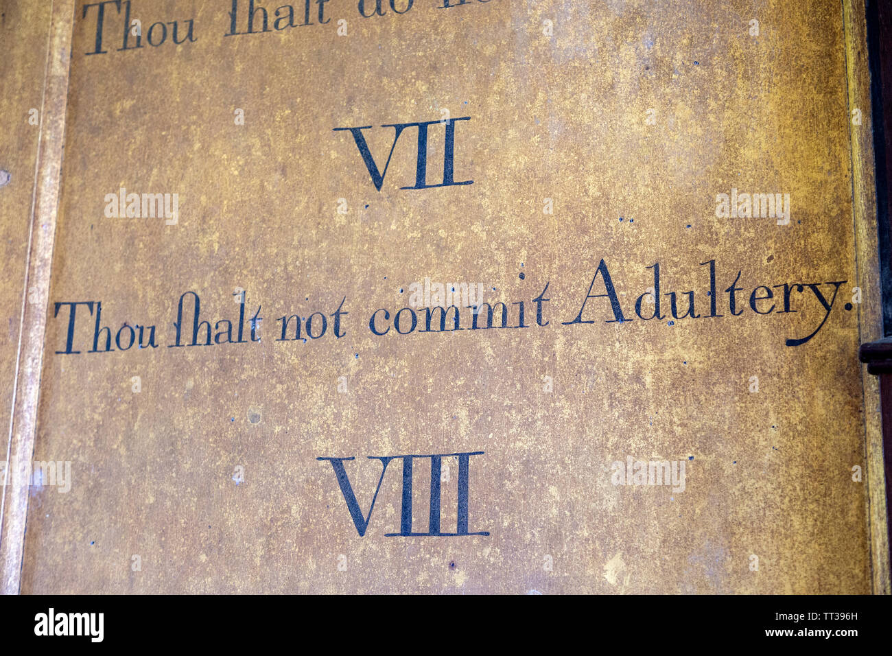 Historic interior of Saint John the Baptist church, Mildenhall, Wiltshire, England, UK 'Thou shalt not commit adultery' commandment - Stock Image