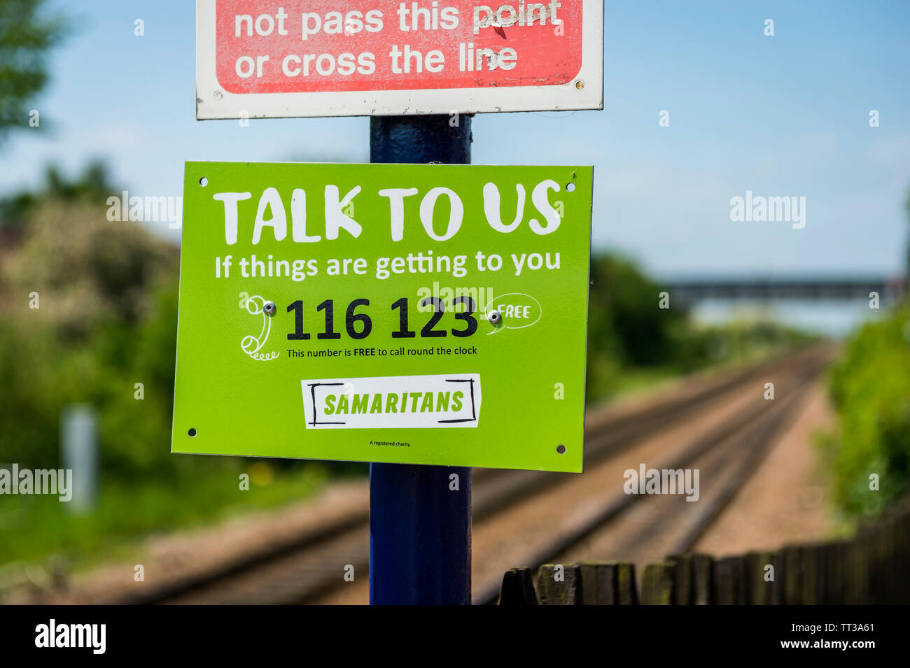 Samaritans sign at the end of the platform at Brough railway station, Yorkshire, England. Stock Photo
