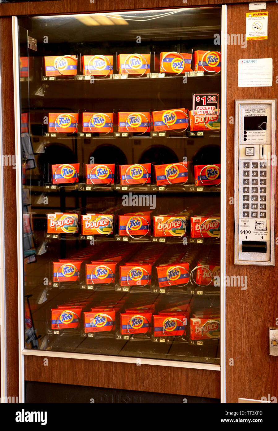 A vending machine in a laundromat selling fabric softener and dryer sheets. Stock Photo