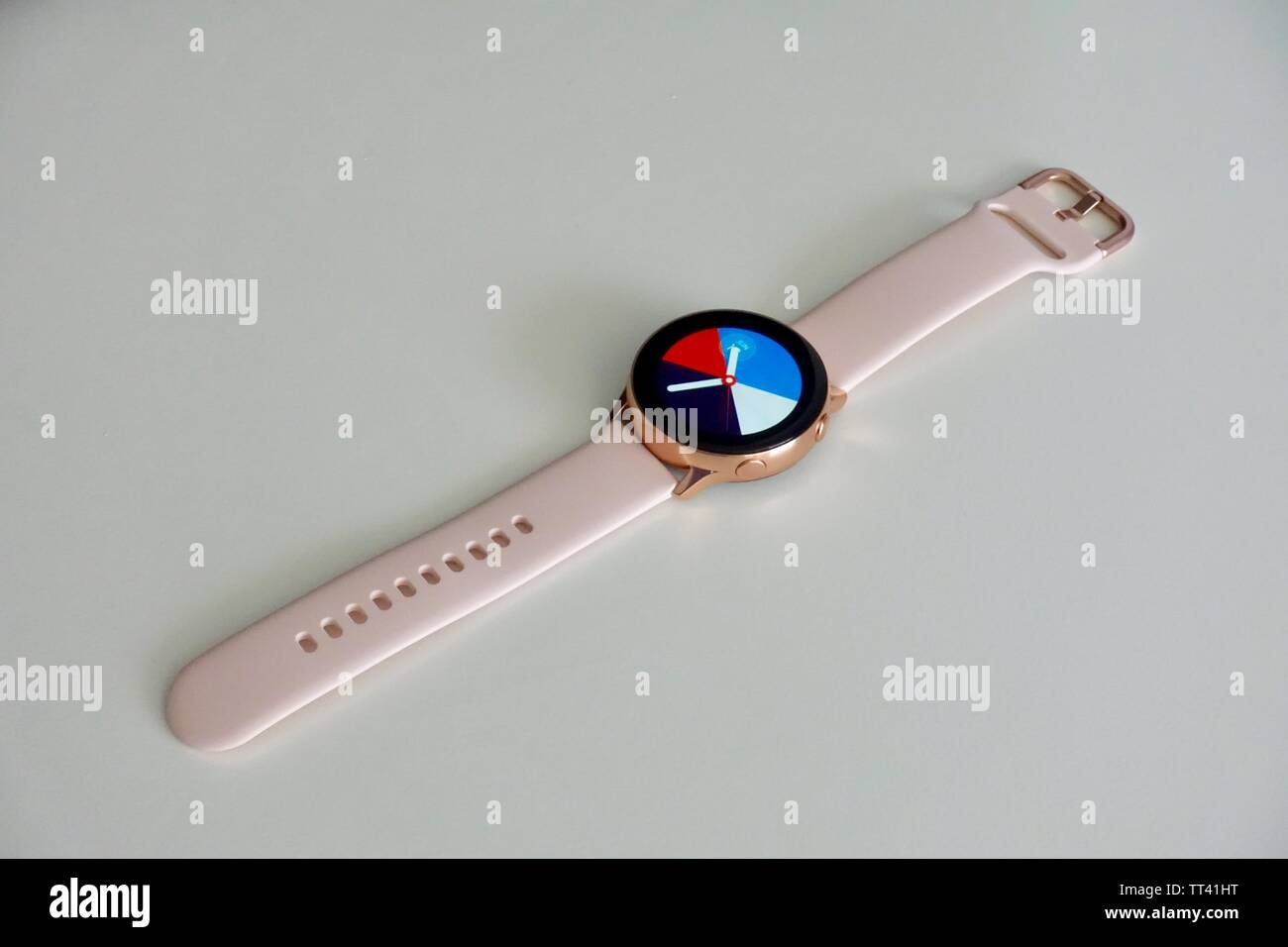 Orlando, FL/USA- 6/7/19: A rose gold Samsung Galaxy Active watch open with a standard watch face. - Stock Image