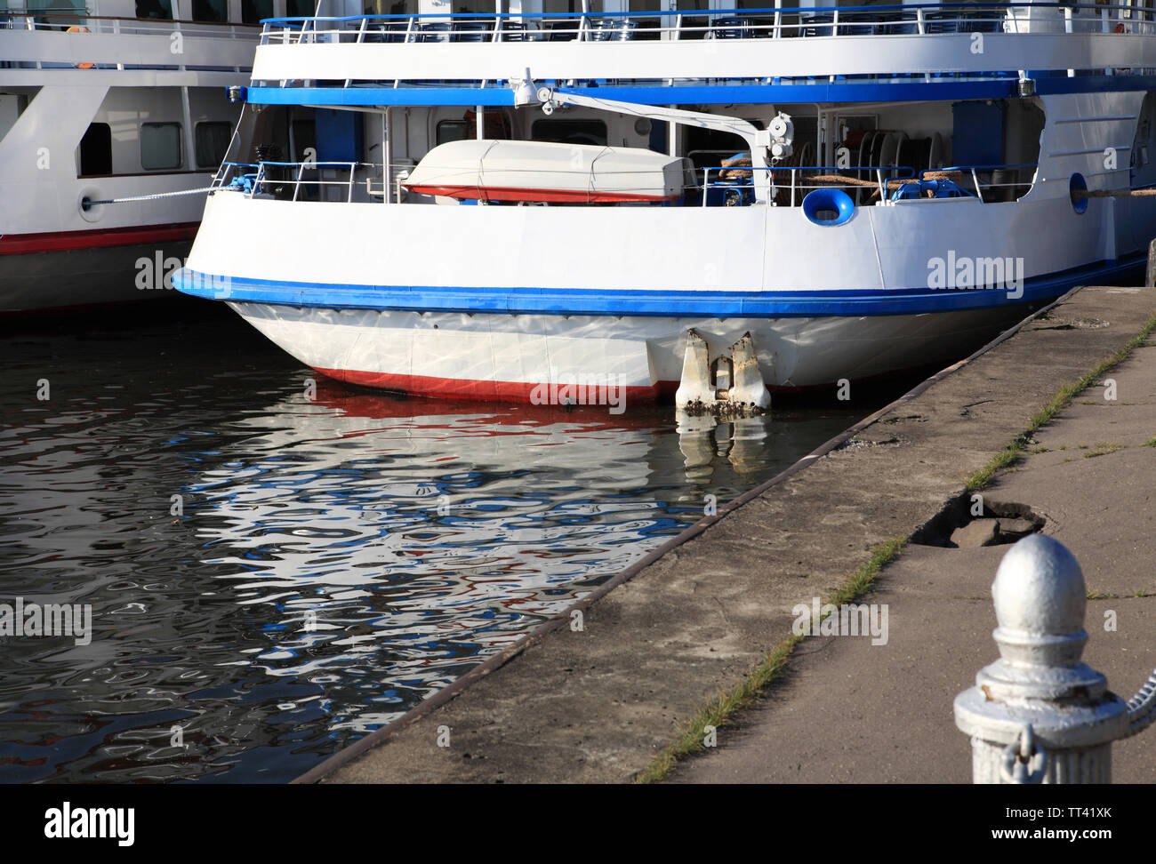 three-dec ship by berth at day to be anchored - Stock Image