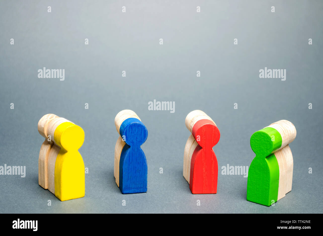 Groups of multicolored wooden people. The concept of market segmentation. Customer relationship management. Target audience, customer care. Groups of - Stock Image