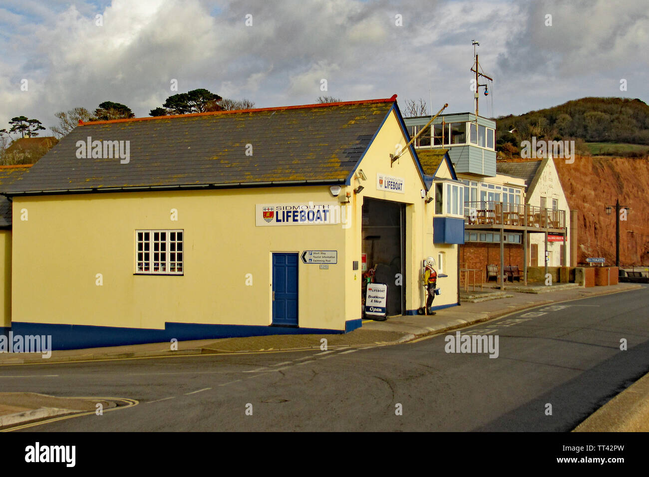 The Lifeboat station at the eastern end of Sidmouth Esplanade. This is a self funded independent organisation - Stock Image