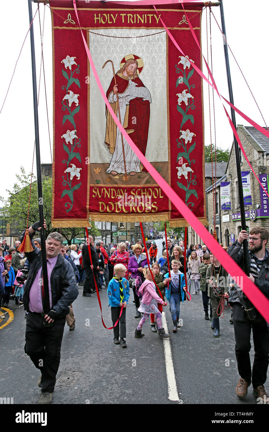 Saddleworth, UK, 14th June, 2019. The annual Friday Whit Walks take place with congregations from churches around the area joining the march to King George V playing fields for a United Service.  Brass Bands from as far a field as Canada marched with the churches and the annual bands contest will be  held later. Credit: Barbara Cook/Alamy Live News - Stock Image