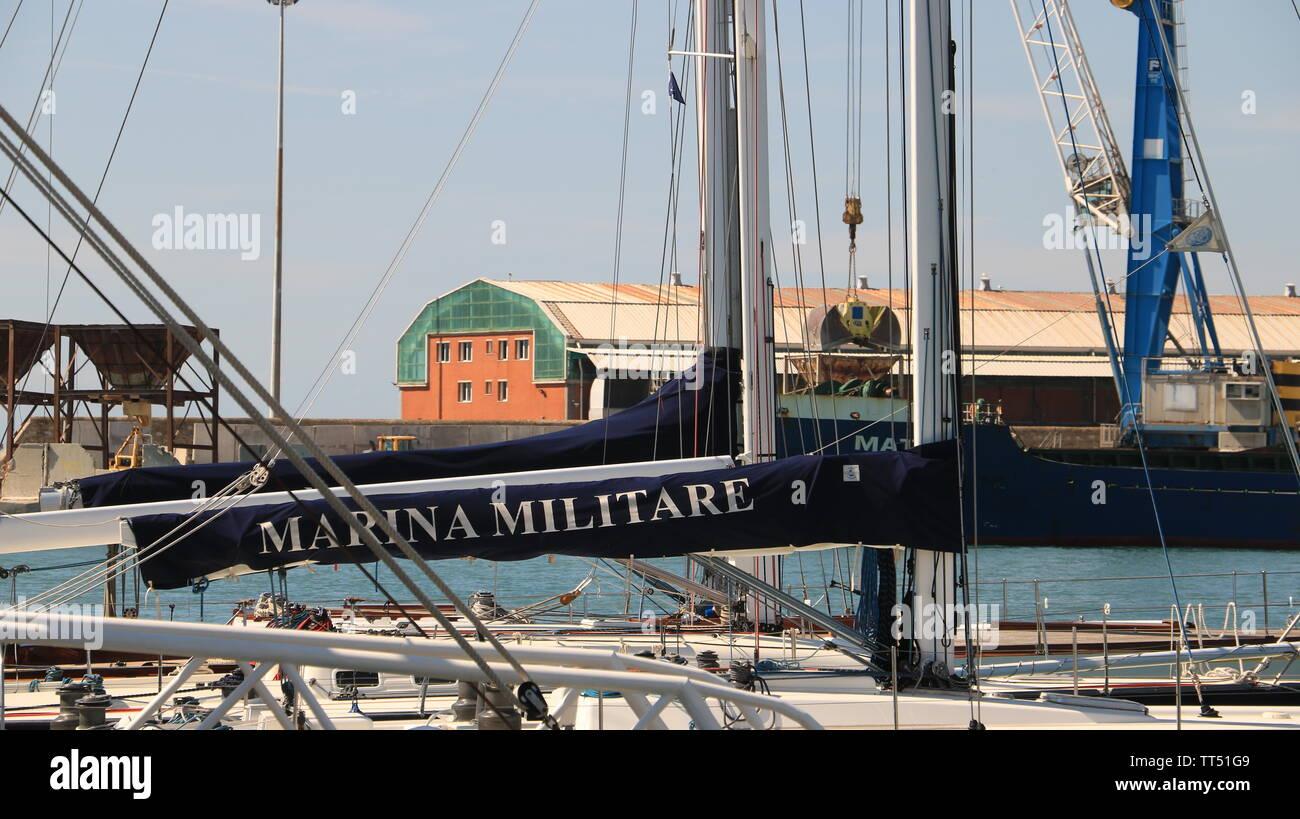 Livorno, Tuscany, Italy. 06/12/2019. Sailboat of the Italian Navy anchored at the dock of the port of Livorno. - Stock Image
