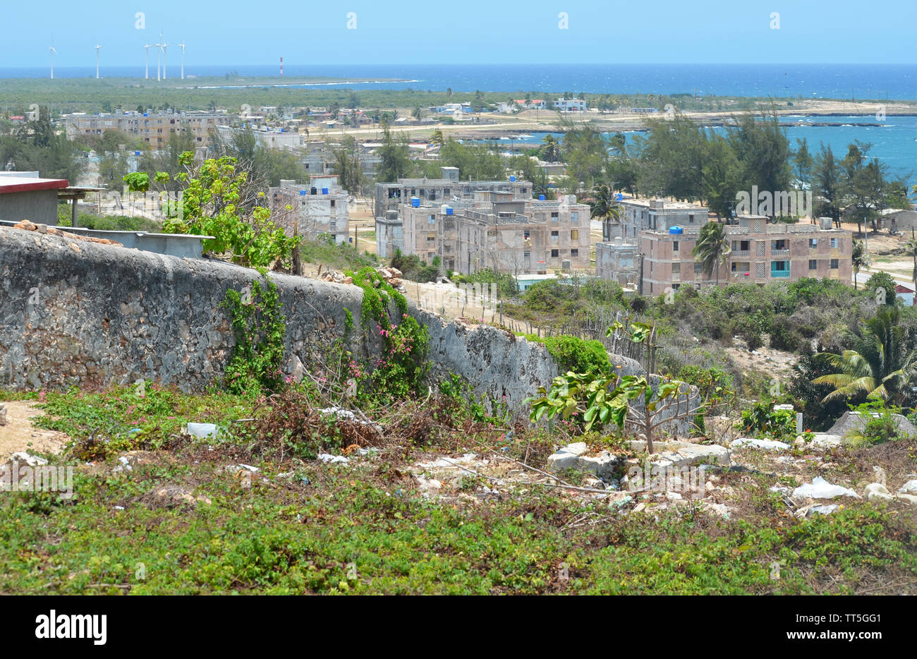 Derelict buildings and concrete apartment blocks in Gibara, Southern Cuba - Stock Image