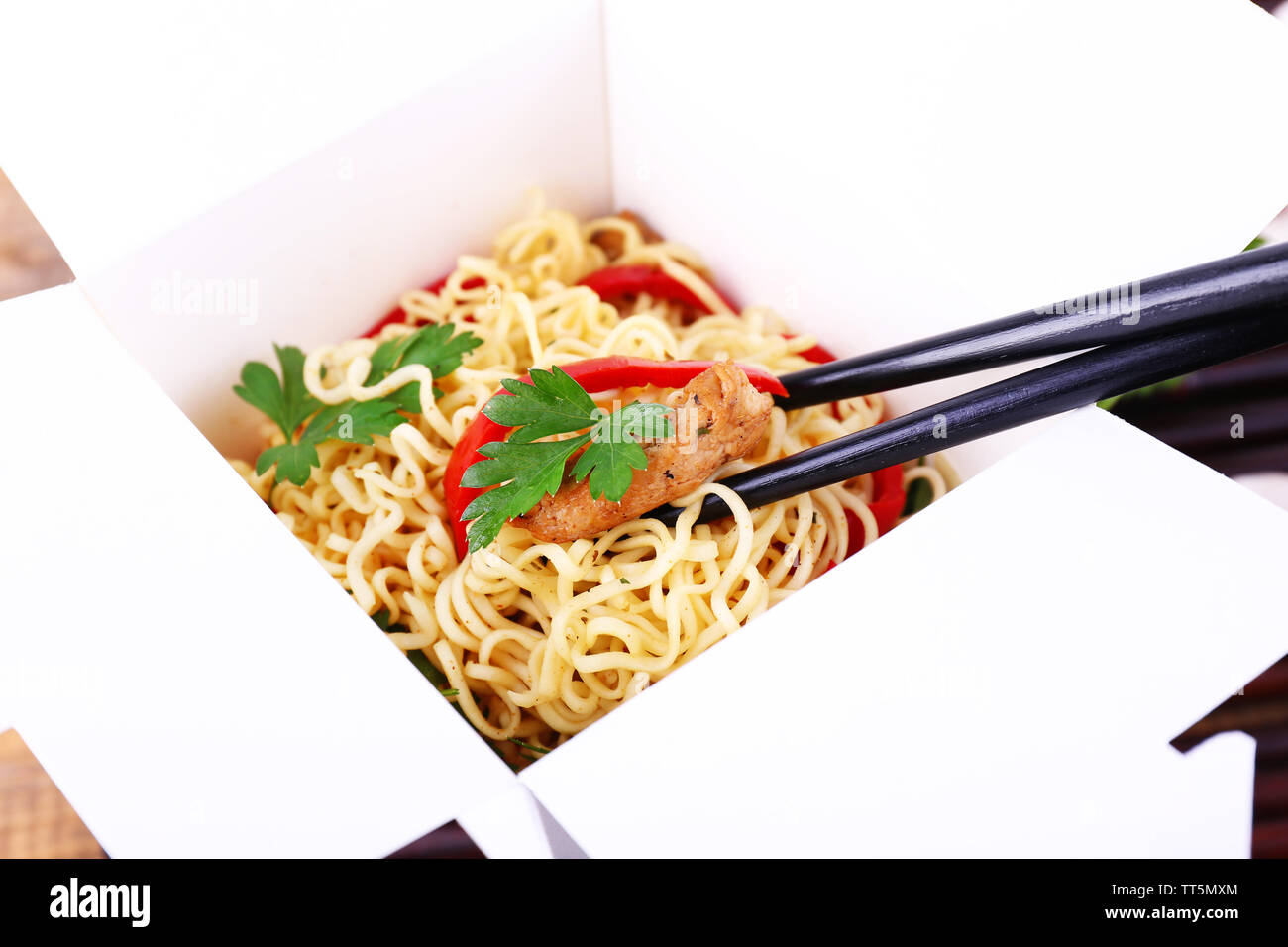 Chinese noodles in takeaway box closeup - Stock Image