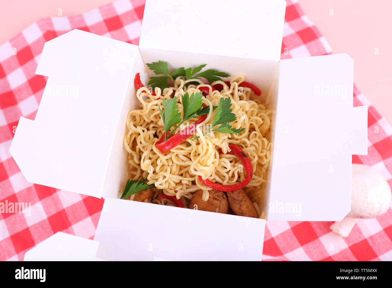Chinese noodles in takeaway boxes on fabric background - Stock Image