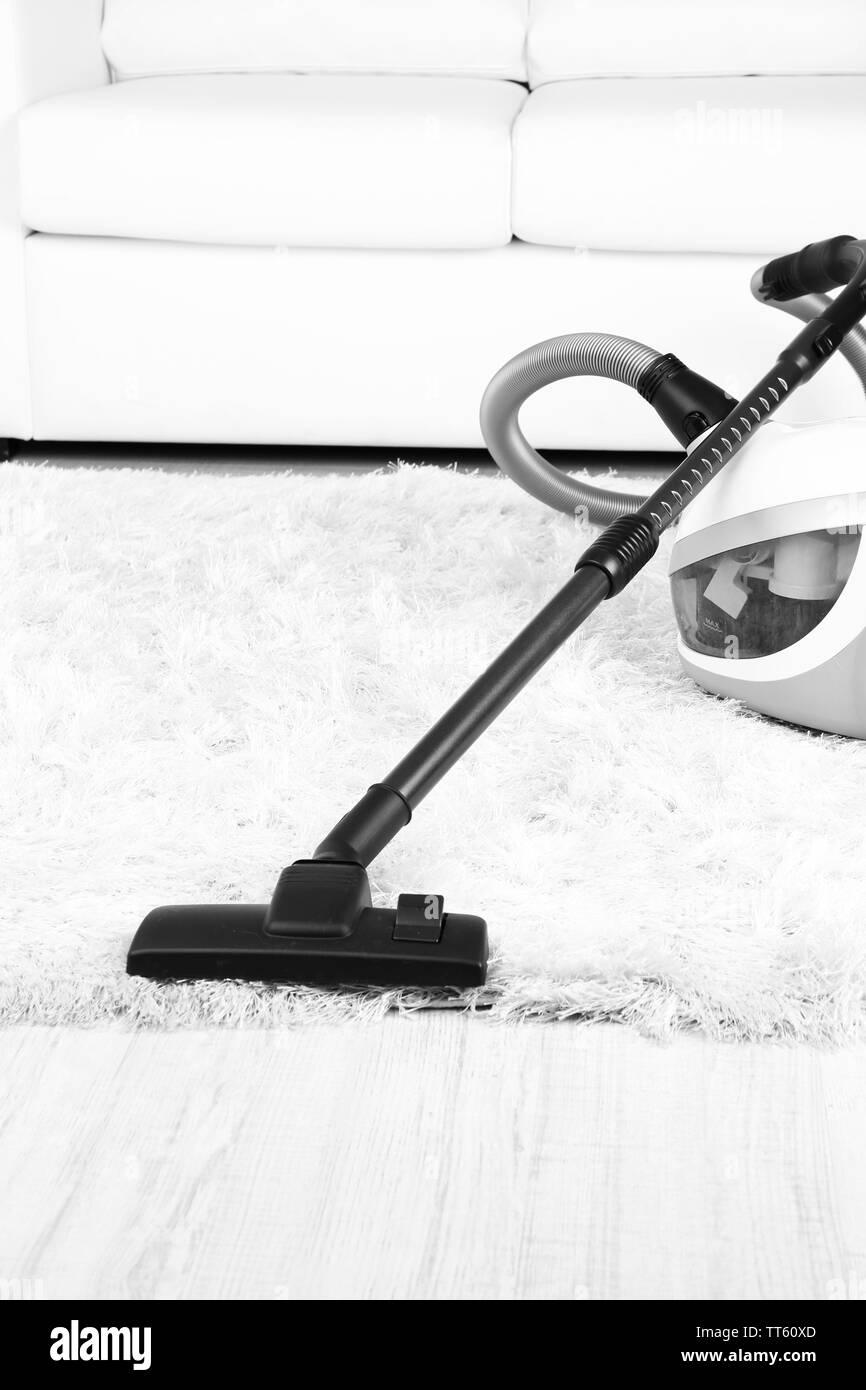 Vacuum on carpet close-up - Stock Image