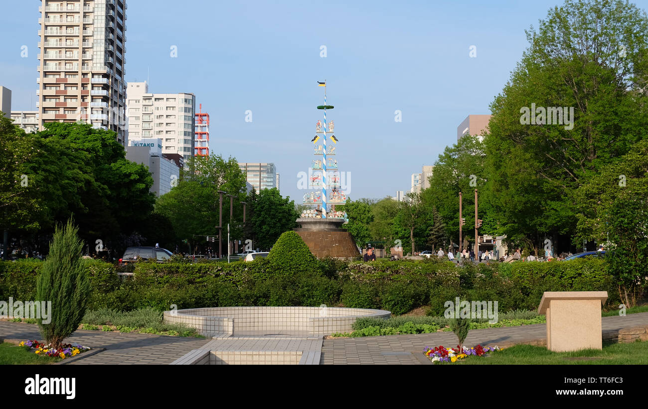 SAPPORO, JAPAN - May 18, 2019: Maibaum, a decorated pole in the German tradition in Odori Park Nishi 11 chome, on a nice sunny day. - Stock Image