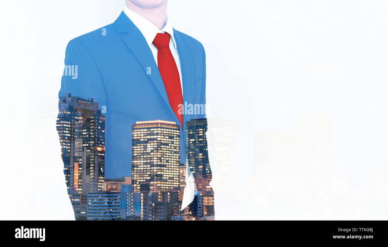 Business concept. Businessman in blue suit and red necktie, with double exposure panoramic business office buildings in the city, on white background Stock Photo