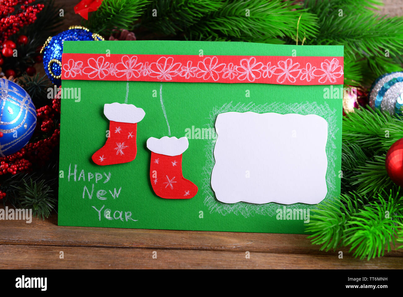 Handmade Christmas Card With Christmas Decorations On Wooden