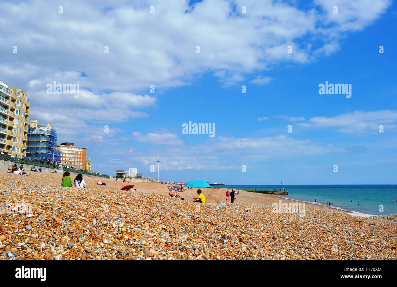 Brighton, UK - August 14, 2016: Beautiful panoramic view to pebble beach at the sea and the famous British Airways i360 observation tower at horizon. Stock Photo