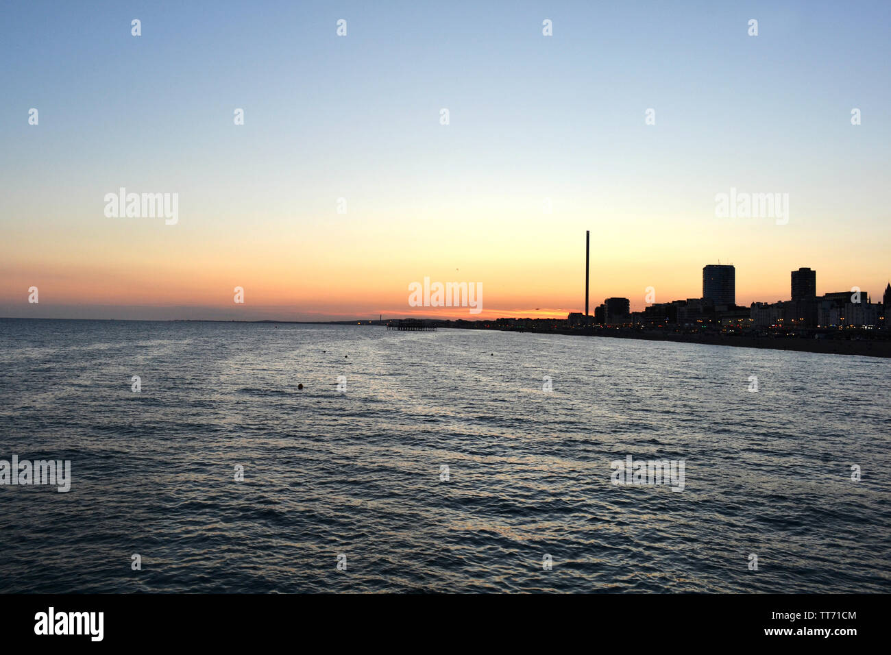 Beautiful panoramic cityscape of Brighton at sunset viewed from the sea. Stock Photo