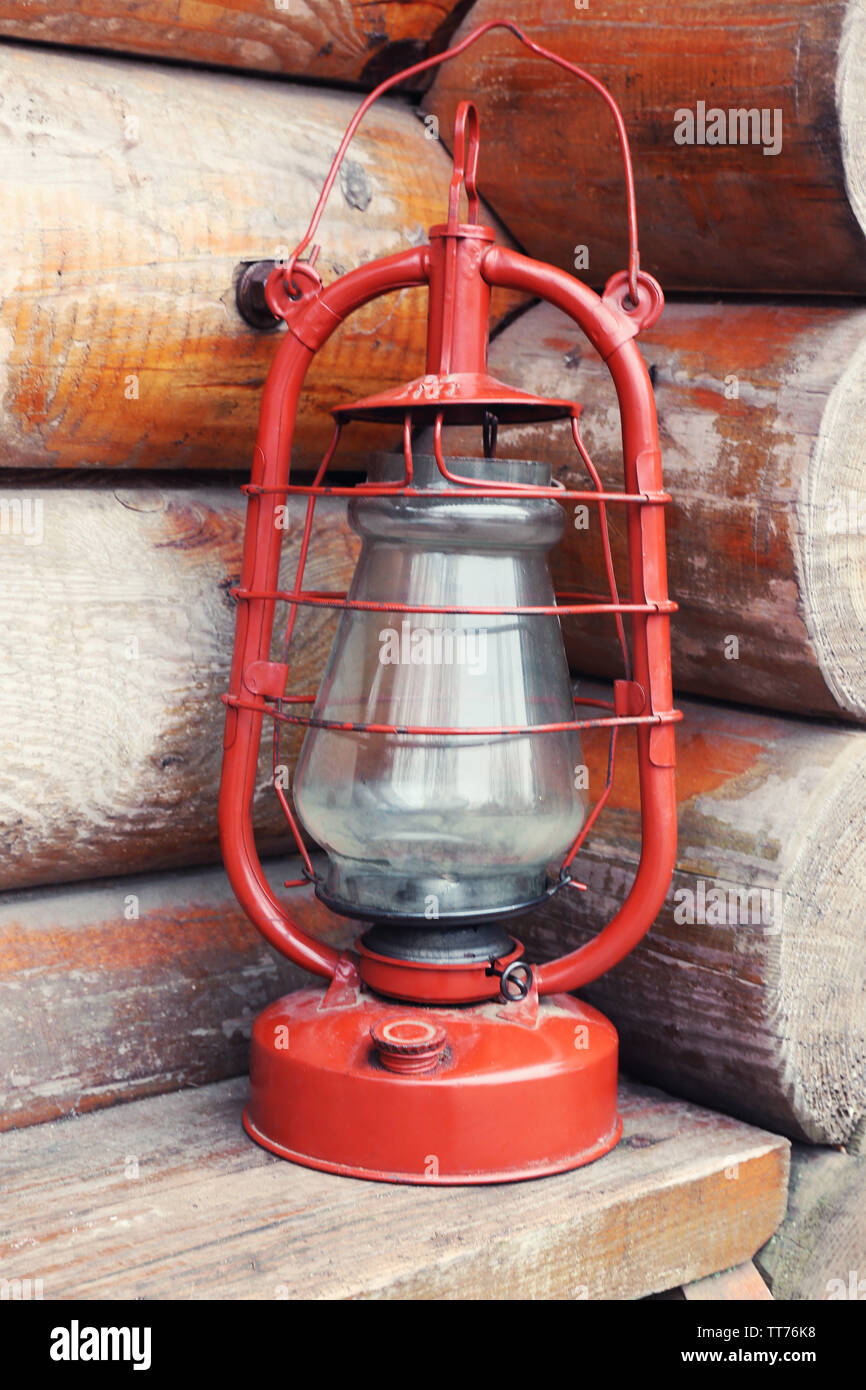 Kerosene lamp on wooden hose background - Stock Image