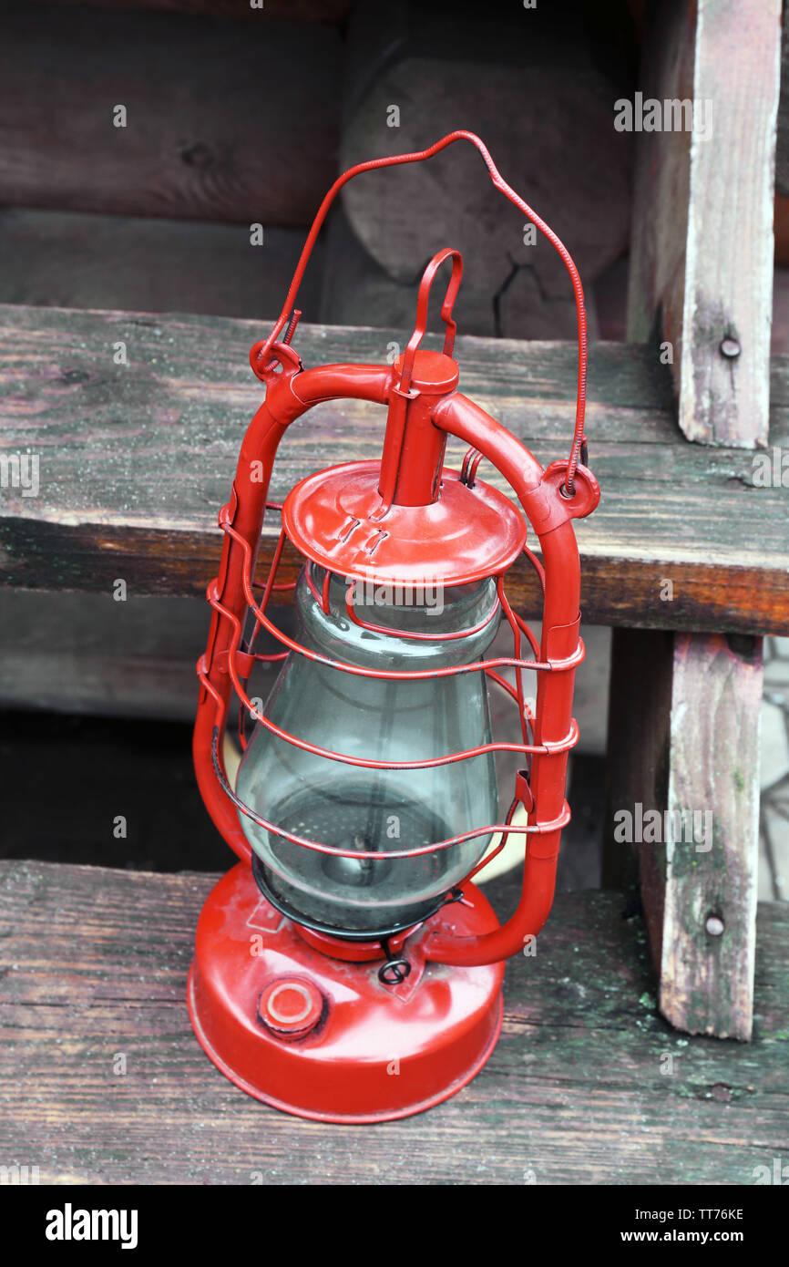 Kerosene lamp on wooden stairs, outdoors - Stock Image