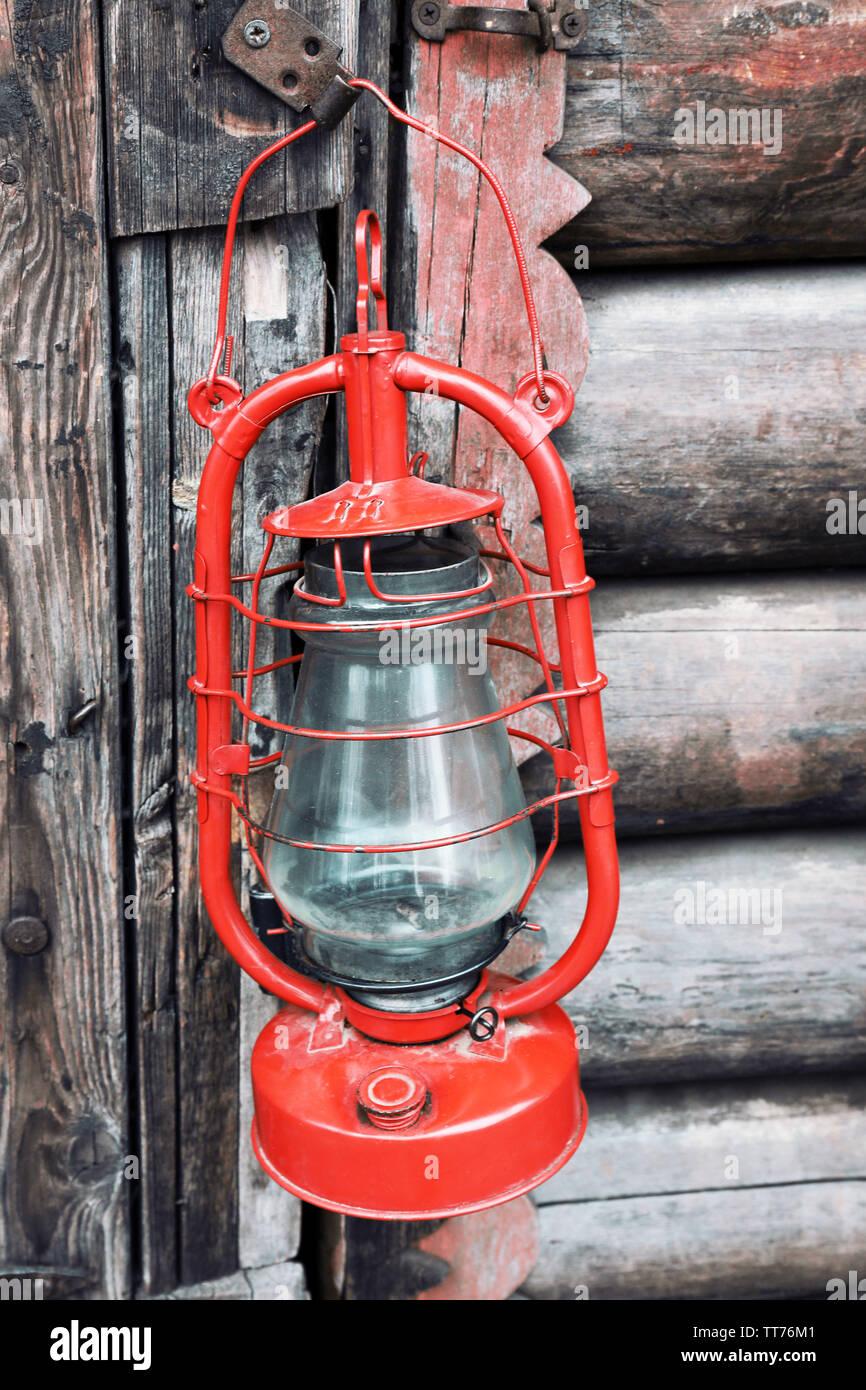 Kerosene lamp on wooden door background - Stock Image