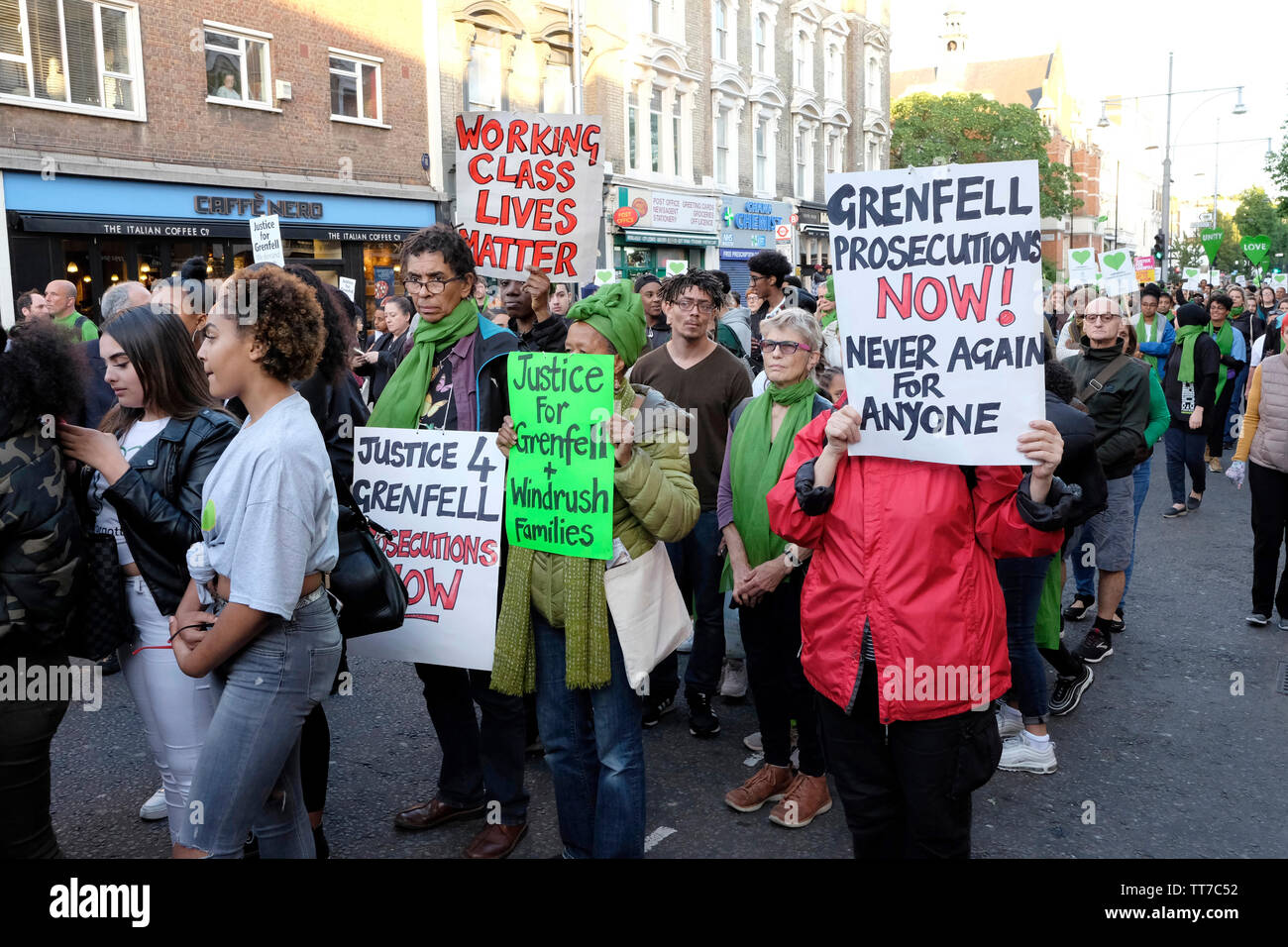 Hundreds of people joined the silent march to remember the victims of Grenfell tragedy. - Stock Image