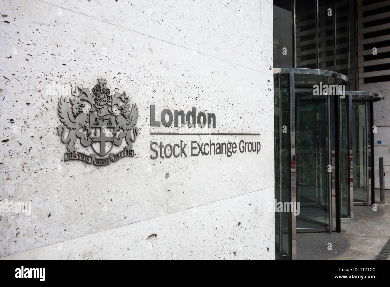 Signage outside the London Stock Exchange coat of arms - My Word is My Bond (Dictum Meum Pactum), outside the LSE on Paternoster Row, London, EC4, UK - Stock Image