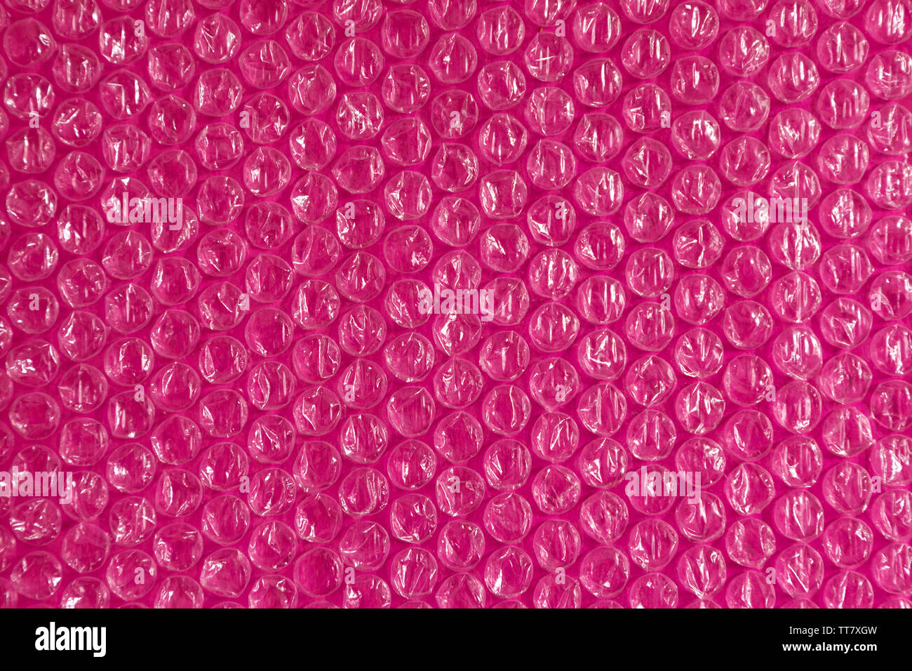 Cellophane and plastic pink background. The texture of old plastic's purple packing with balls. Image lilac and white tones. - Stock Image