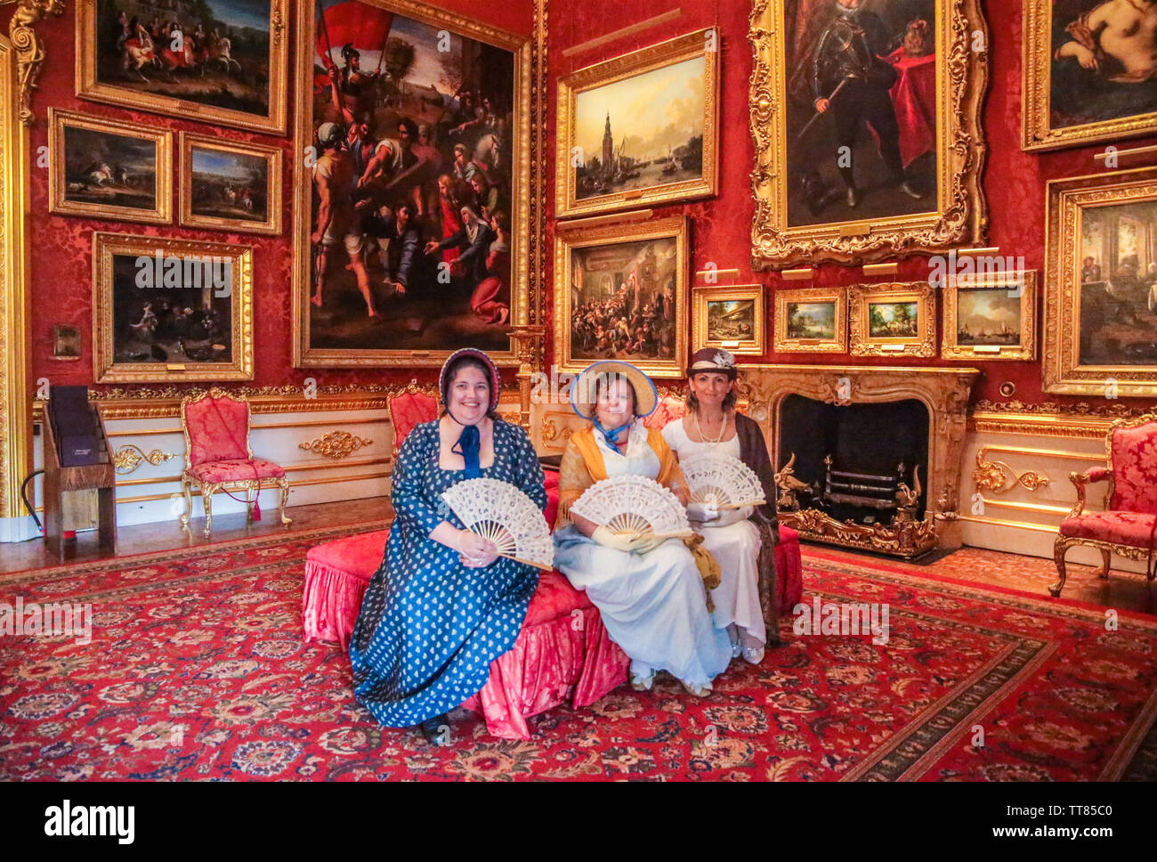 London, UK. 15 June 2019.Three Actresses in period costum in  The Waterloo Gallery is the final element of Benjamin Dean Wyatt's work on Apsley House completed in 1830. The style is French revival and has been described as after Louis XIV, Louis XV or Louis XVI. In reality it is an eclectic mix which was a hallmark of Wyatt's work. The gallery is double height; there is no second floor or attic in this part of the house. When Wyatt's designs for York (now Lancaster) House were delayed in 1826 they were re-worked for Apsley House.Paul Quezada-Neiman/Alamy Live News Credit: Paul Quezada-Neiman/ - Stock Image