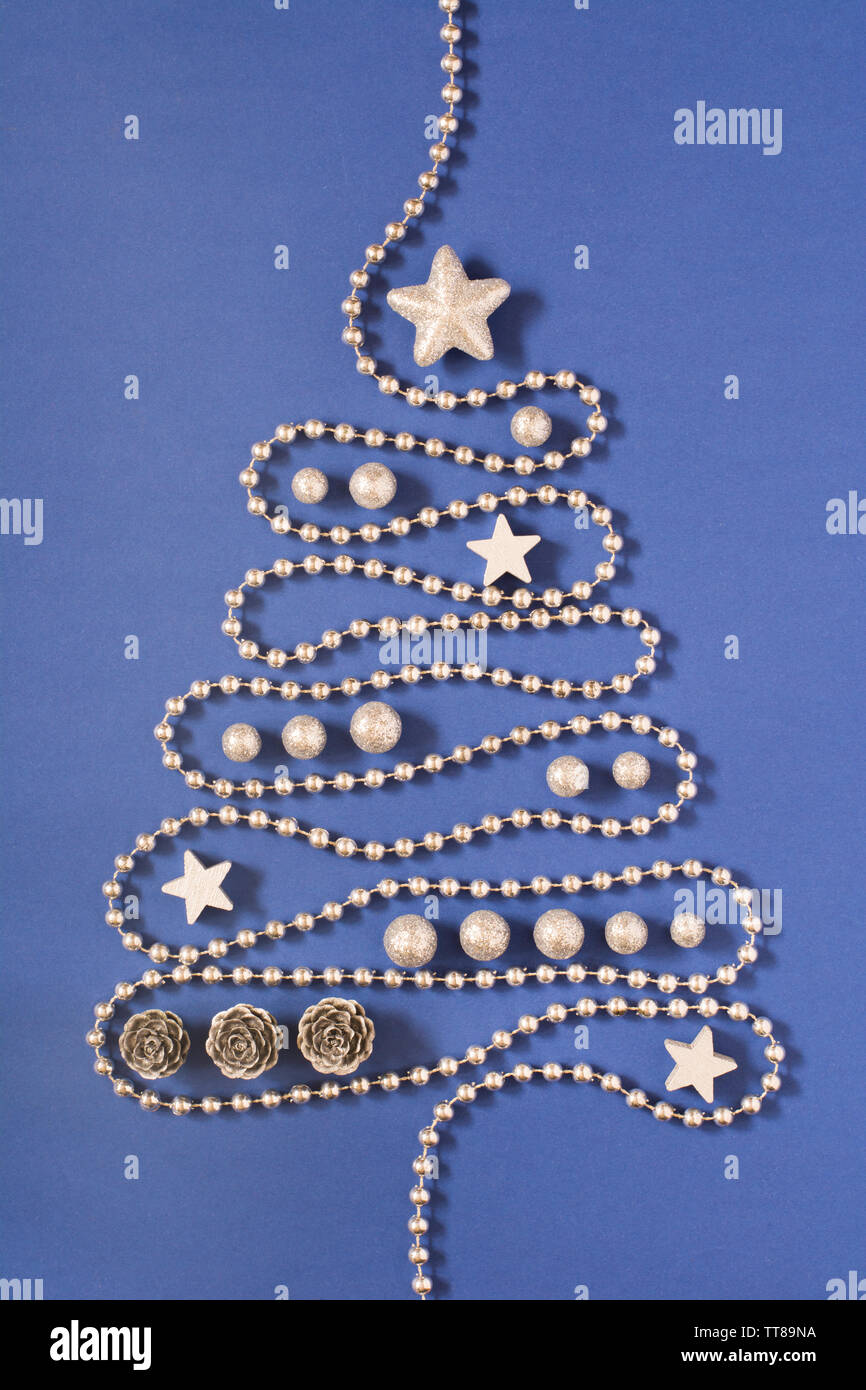 Christmas Tree Concept With Silver Bead Chain Silver Stars Cones And Globules On Dark Blue Background Stock Photo Alamy