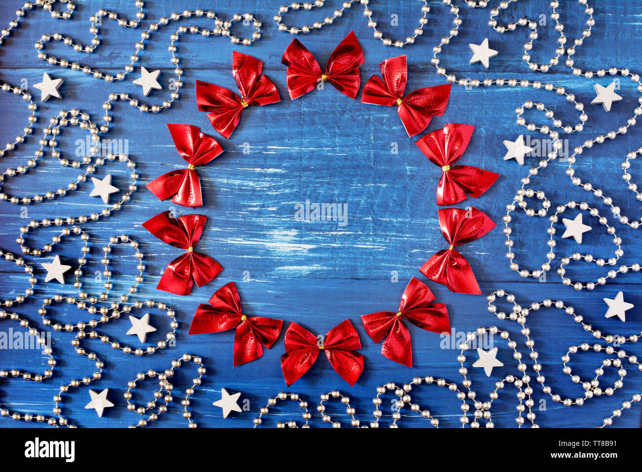 Christmas Chain Text.Christmas Decoration With A Cirle Of Red Ribbons Silver